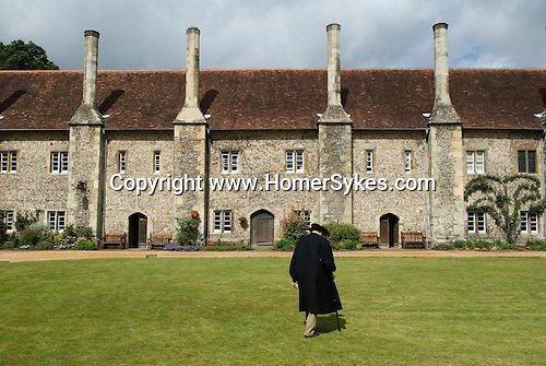 "Hospital of St Cross & Almshouse of Noble Poverty Winchester Haampshire England 2009. The term ""Hospital"" has the same origin as ""hospitality"" and for over 850 years St Cross has provided food and shelter to people in need. It has been home to the Master and Brethren of St Cross since medieval times and today visitors can still receive the Wayfarer's Dole (a small beaker of beer and a morsel of bread)."