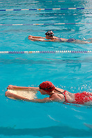 28 OCT 2003 - PAPHOS, CYP - Leanda Cave (front) and Jessica Harrison train in the pool during the British Triathlon Elite Training Camp (PHOTO (C) NIGEL FARROW)