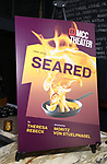 """Poster signage during the photo call for the cast and creative team of MCC Theater's New York Premiere of """"Seared"""" on September 11, 2019 at Artesia Wine Bar in New York City."""