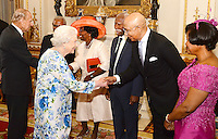 10 June 2016 - London, England - Prince Philip Duke of Edinburgh and Queen Elizabeth II shakes hands with Sir Patrick Allen of Jamaica, during a reception ahead of the Governor General's lunch at Buckingham Palace in London. Photo Credit: ALPR/AdMedia