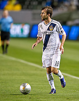 CARSON, CA - March 31, 2012: Mike Magee (18) of the Galaxy during the LA Galaxy vs New England Revolution match at the Home Depot Center in Carson, California. Final score LA Galaxy 1, New England Revolution 3.