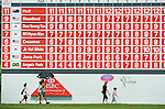 SINGAPORE - MARCH 08:  People walk past in front of the scoreboard during the final round of HSBC Women's Champions at the Tanah Merah Country Club on March 8, 2009 in Singapore.  Photo by Victor Fraile / The Power of Sport Images