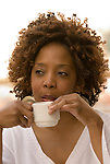 African American woman sipping coffee and thinking