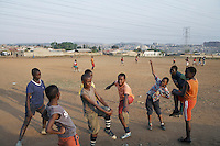 SOWETO, SOUTH AFRICA - SEPTEMBER 14: Unidentified boys warm up before a soccer a practice on September 14, 2007 in the Diepkloof section Soweto, South Africa. Soccer is the most popular sport in South Africa, and a because of the upcoming World Cup 2010 in South Africa the interest is increasing. For the first time the World Cup will be held on the African continent. South Africa doesn't have an organized youth soccer program and many teams and players struggle with lack of funds, to buy equipment and money for transport to games. .(Photo by Per-Anders Pettersson)...