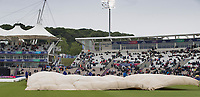 The ground staff quickly get the covers in place during South Africa vs West Indies, ICC World Cup Cricket at the Hampshire Bowl on 10th June 2019