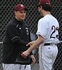 Brian Porricelli #23, Mepham starting pitcher, gets congratulated by head coach Bill Murphy after throwing a complete game shutout against MacArthur in a Nassau County varsity baseball game at Mepham High School on Thursday, April 27, 2017. He struck out eight batters in Mepham's 3-0 win.