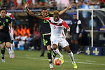 15 July 2015: Joevin Jones (TRI) (3) and Paul Aguilar (MEX) (22). The Mexico Men's National Team played the Trinidad & Tobago Men's National Team at Bank of America Stadium in Charlotte, NC in a 2015 CONCACAF Gold Cup Group C match. The game ended in a 4-4 tie.