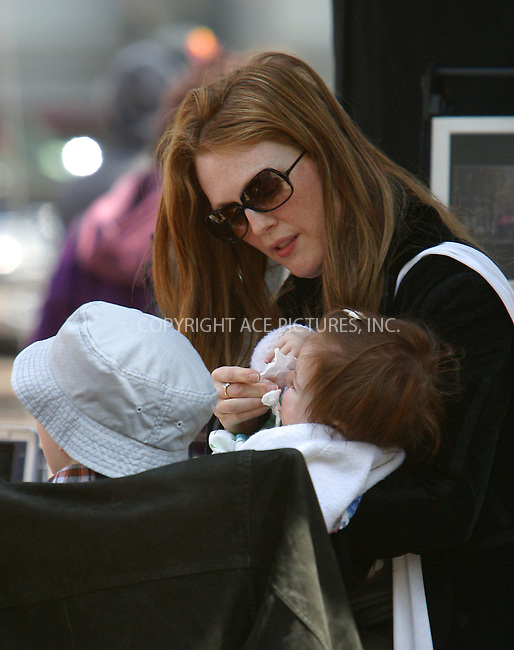 "Actress Julianne Moore and her director boyfriend Bart Freundlich brought their two children, son Cal and daughter Liv, to the set of ""Spider-Man 2"" which was filmed in Downtown by the Brooklyn Bridge. Moore and Freundlich, who recently announced their engagement, visited some friends on the set, while daughter Liv took some walking lessons from her daddy. New York, April 20, 2003. Please byline: Alecsey Boldeskul/NY Photo Press.   ..*PAY-PER-USE*      ....NY Photo Press:  ..phone (646) 267-6913;   ..e-mail: info@nyphotopress.com"