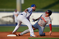 St. Lucie Mets shortstop Todd Frazier (19), on rehab assignment, looks to tag Greyson Jenista sliding in during a Florida State League game against the Florida Fire Frogs on April 12, 2019 at First Data Field in St. Lucie, Florida.  Florida defeated St. Lucie 10-7.  (Mike Janes/Four Seam Images)