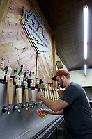 NWA Democrat-Gazette/DAVID GOTTSCHALK Joseph Eaton pours one of the a drafts available in the new downtown taproom for the Fort Smith Brewing Company located at 115 N. 10th Street at Brunwick Place in downtown Fort Smith.
