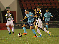 Stephen Husband being challenged by Kealan Dillon in the St Mirren v Dunfermline Athletic Scottish Professional Football League Under 20 match played at the Excelsior Stadium, Airdrie on 11.12.13.