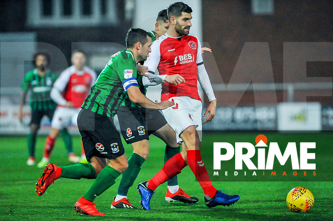 Fleetwood Town's forward Ched Evans (9) lays off the ball under pressure during the Sky Bet League 1 match between Fleetwood Town and Coventry City at Highbury Stadium, Fleetwood, England on 27 November 2018. Photo by Stephen Buckley / PRiME Media Images.