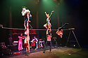 London, UK. 10.04.2014. Australian circus ensemble, Company 2, bring SHE WOULD WALK THE SKY to the Roundhouse, as part of CircusFest 2014. Picture shows: Kane Petersen (The Clown), Alex Mizzen (The Distant One), Jessica McCrindle (The Gate Keeper), Dniel Catlow (The Gate Keeper) and Mozes (The Stoic One), with Sue Simpson (The Red Woman, on violin) and Trent Arkleysmith (The Keeper of Time) behind.Photograph © Jane Hobson.