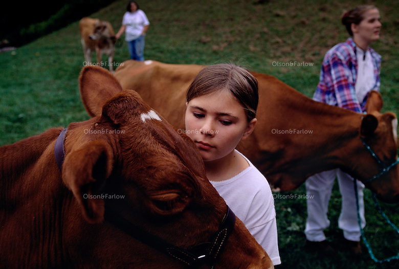 Girls with their cows at the Tunbridge Fair in Vermont.