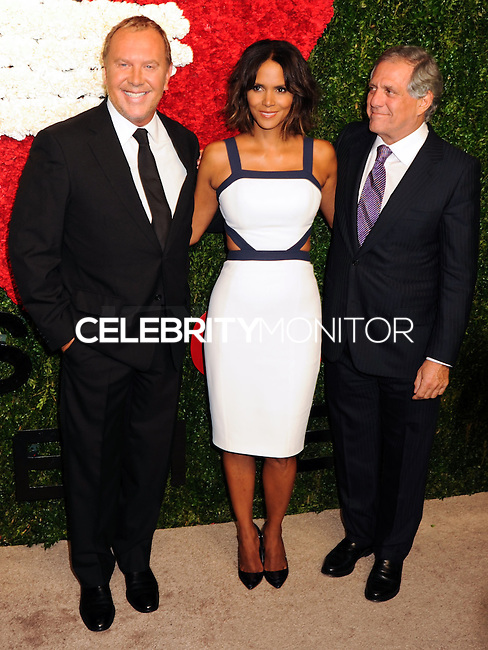NEW YORK CITY, NY, USA - OCTOBER 16: Michael Kors, Halle Berry, Leslie Moonves arrive at the God's Love We Deliver, Golden Heart Awards held at Spring Studios on October 16, 2014 in New York City, New York, United States. (Photo by Celebrity Monitor)