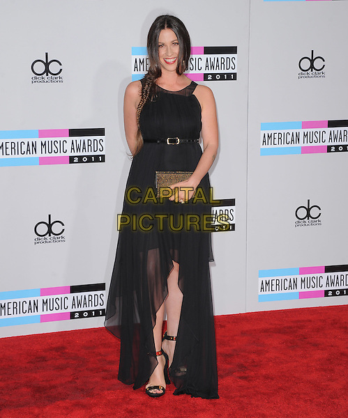 Alanis Morissette.2011 American Music Awards - Arrivals held at Nokia Theatre LA Live, Los Angeles, California, USA..November 20th, 2011.ama amas ama's full length black dress sheer sleeveless belt clutch bag gold.CAP/RKE/DVS.©DVS/RockinExposures/Capital Pictures.