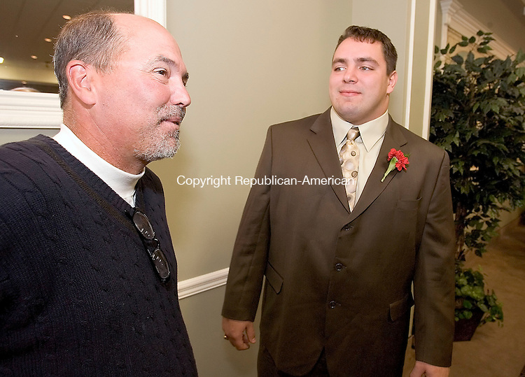 WATERTOWN, CT-- 18 NOVEMBER 2007--111807JS01-Watertown High School football coach Roger Ouellette, left, talks with former player Tony Fusco on during the 12th annual Watertown High School Gridiron Club's Hall of Fame enshrinement dinner held Sunday at the Grand Oak Villa in Watertown. Fusco,a senior at the United States Military Academy at West Point, was honored at the event as the College Player of the Year.<br /> Jim Shannon / Republican-American