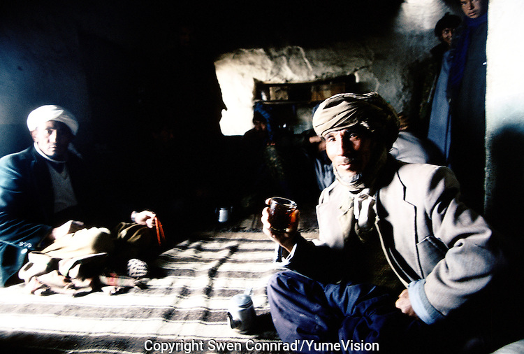 Ferrymans resting in a tea house after passing the Wonay Pass at 3352 meters high on the way to Bamiyan charge with food. Hazarajat, Afghanistan.