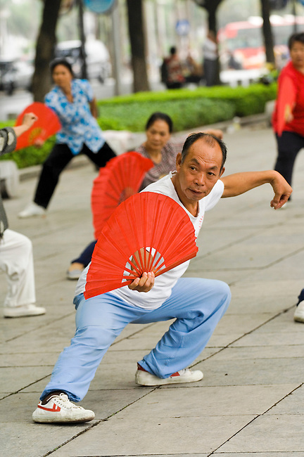 Morning Tai Chi exercise by river, Guilin