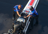 Jun 17, 2016; Bristol, TN, USA; Crew members with NHRA top fuel driver Richie Crampton during qualifying for the Thunder Valley Nationals at Bristol Dragway. Mandatory Credit: Mark J. Rebilas-USA TODAY Sports