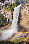 A photo of Vernal Falls in the springtime with a mist rainbow. Yosemite National Park, CA