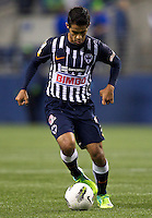 Severo Meza of CF Monterrey dribbles the ball during a CONCACAF Champions League match against the Seattle Sounders FC at CenturyLink Field in Seattle Tuesday Oct. 18, 2011. CF Monterrey won the game 2-1.