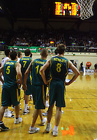 The Boomers look towards the scoreboard as they trail 69-53 during the third quarter during the International basketball match between the NZ Tall Blacks and Australian Boomers at TSB Bank Arena, Wellington, New Zealand on 25 August 2009. Photo: Dave Lintott / lintottphoto.co.nz
