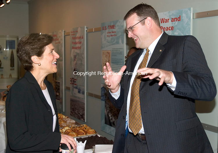 WATERBURY, CT. 27 October 2010-102710SV01--From left, Nancy Becker, Torrington Supply Company Inc., talks with Chad Wable, St. Mary's Hospital, during the United Way of Greater Waterbury's annual meeting held at the Timex Museum in Waterbury Wednesday. Becker is the board chairman and will be turning the position over to Wable who wad the first vice chair.<br /> Steven Valenti Republican-American