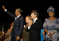 Montreal (Qc) CANADA, June 20, 1990 File Photo.<br /> <br /> South African opposition leader Nelson Mandela (R) raise his fist to salute the crowd right after his speech in front the black community in Montreal (Quebec, Canada) on June 20, 1990, while Jean Dore (L) ; the Mayor of Montreal at that time is applauding.<br /> <br /> <br /> <br /> Photo (c) 1990, by Pierre Roussel - IMAGES DISTRIBUTION