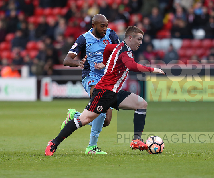 John Fleck of Sheffield United running beyond Nigel Atangana of Leyton Orient during the Emirates FA Cup Round One match at Bramall Lane Stadium, Sheffield. Picture date: November 6th, 2016. Pic Simon Bellis/Sportimage