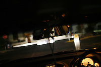 CAPE TOWN, SOUTH AFRICA - JULY 26: A man drives at night in Cape Town, South Africa.   (Photo by Landon Nordeman) ..