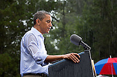 "July 14, 2012.""The President delivers remarks in the pouring rain at a campaign event in Glen Allen, Virginia. He was supposed to do a series of press interviews inside before his speech, but since people had been waiting for hours in the rain he did his remarks as soon as he arrived onsite so people."".Mandatory Credit: Pete Souza - White House via CNP"
