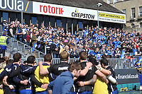 Bath supporters watch their team huddle together during the pre-match warm-up. Amlin Challenge Cup quarter-final, between Bath Rugby and Stade Francais on April 6, 2013 at the Recreation Ground in Bath, England. Photo by: Patrick Khachfe / Onside Images