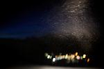 Snow swirls in the headlights of a snowcat on Mammoth Mountain, Calif., january 28, 2011.
