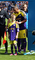 Pictured: Ashley Williams and mascot.<br />