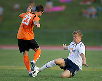 Johan Elmander of the Bolton Wanderers slides against Chad Smith of the Charlotte Eagles.  The Charlotte Eagles currently in 3rd place in the USL second division play a friendly against the Bolton Wanderers from the English Premier League.