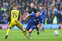 Craig Bryson of Cardiff City is tackled by Tom Naylor of Burton Albion during the Sky Bet Championship match between Cardiff City and Burton Albion at the Cardiff City Stadium, Wales, UK. Friday 30 March 2018