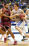 BROOKINGS, SD - FEBRUARY 8:  Brayden Carlson #12 from South Dakota State drives against Marcellus Barksdale #22 from IUPUI in the first half of their game Saturday afternoon at Frost Arena in Brookings. (Photo by Dave Eggen/Inertia)