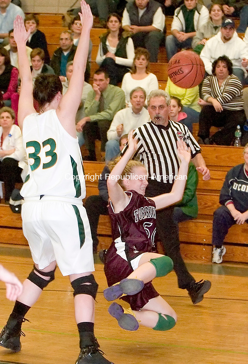 WATERBURY, CT-- 08 JANUARY 2008--010808JS10-Torrington's Michelle Royals (50) gets tripped up while being defended by Holy Cross' Tara Stevenson(33) during their game Tuesday at Holy Cross High School in Waterbury. <br /> Jim Shannon/Republican-American