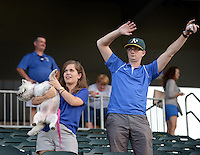 NWA Democrat-Gazette/BEN GOFF &bull; @NWABENGOFF<br /> Allison Giezentanner, Houston Harrison and Roxi of Fayetteville stand up for the seventh inning stretch on Sunday Aug. 16, 2015 during Bark in the Ballpark night at the Northwest Arkansas Naturals game in Arvest Ballpark in Springdale.
