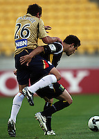 Newcastle's Mark Milligan hitches a ride on Daniel during the A-League match between Wellington Phoenix and Newcastle Jets at Westpac Stadium, Wellington, New Zealand on Sunday, 4 January 2009. Photo: Dave Lintott / lintottphoto.co.nz