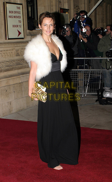 SAFFRON ALDRIDGE.Cirque Du Soleil charity performance at the Royal Albert Hall and aftershow dinner at the V&A Museum.full length, full-length, long black dress, fur wrap, gold handbag.www.capitalpictures.com.sales@capitalpictures.com.© Capital Pictures.