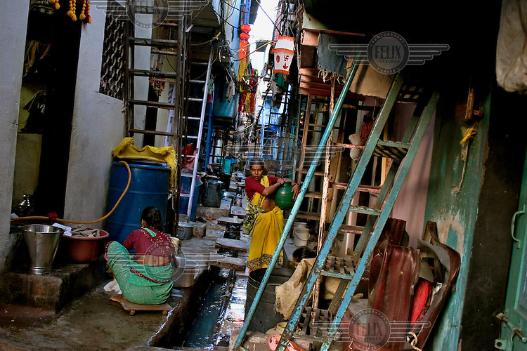 A narrow residential alley in the Dharavi slum, where around a million people are packed into a square mile of low-rise housing.