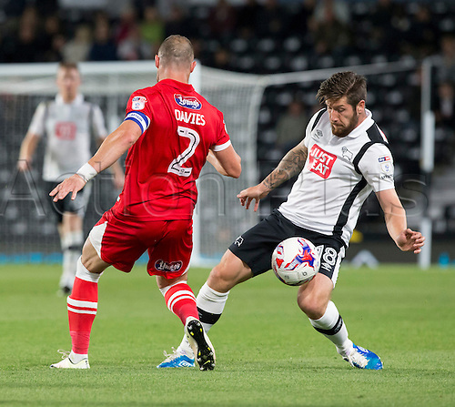 09.08.2016. iPro Stadium, Derby, England. Football League Cup 1st Round. Derby versus Grimsby Town. Derby County midfielder Jacob Butterfield maintains possession of the ball as Grismby Town midfielder Ben Davies comes in for the tackle.