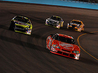 Apr 22, 2006; Phoenix, AZ, USA; Nascar Nextel Cup driver Tony Stewart of the (20) Home Depot Chevrolet Monte Carlo leads Kyle Busch during the Subway Fresh 500 at Phoenix International Raceway. Mandatory Credit: Mark J. Rebilas-US PRESSWIRE Copyright © 2006 Mark J. Rebilas..