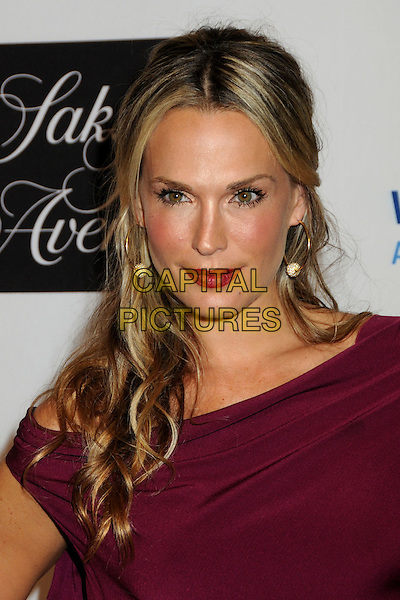 MOLLY SIMS.EIF's Women's Cancer Research Fund Benefit held at the Beverly Wilshire Hotel, Beverly Hills, California, USA..January 27th, 2010.headshot portrait simms purple maroon red lipstick gold hoop earrings .CAP/ADM/BP.©Byron Purvis/AdMedia/Capital Pictures.