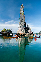 Raja Ampat Archipelago, West Papua, Indonesia, December 2010. Spectacular limestone rock formations and sharp pinnacles are the seascape for our kayaking adventure in North Kaboei Bay. Thousands of small islands fringed by coral reefs and blue water mangroves litter the Raja Ampat archipelago. The turquoise and blue waters are teeming with marine life that forms the livelihood for the local Papuan population. The Raja Ampat Research & Conservation Centre (RARCC) supports the locals to develop a community based, sustainable tourism project, inviting visitors to explore their islands by sea kayak and experience the culture by staying amongst the local people in traditional style homestays. Photo by Frits Meyst/Adventure4ever.com