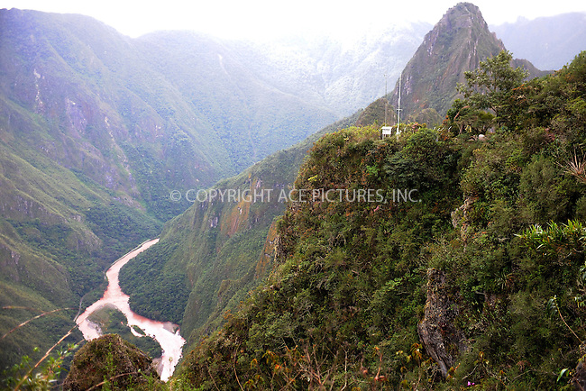 "WWW.ACEPIXS.COM . . . . . .January 8, 2013...Peru...Huayna Picchu also known as Wayna Picchu (Quechua: ""Young Peak"") is a mountain in Peru around which the Urubamba River bends. It rises over Machu Picchu, the so-called lost city of the Incas, and divides it into sections. The Incas built a trail up the side of the Huayna Picchu and built temples and terraces on its top. The peak of Huayna Picchu is about 2,720 metres (8,920 ft) above sea level, or about 360 metres (1,180 ft) higher than Machu Picchu.on January 8, 2013 in Peru ....Please byline: KRISTIN CALLAHAN - ACEPIXS.COM.. . . . . . ..Ace Pictures, Inc: ..tel: (212) 243 8787 or 212 489 0521..e-mail: kristincallahan@aol.com...web: http://www.acepixs.com ."