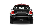 Straight rear view of a 2017 Mini MINI John Cooper Works 3 Door Hatchback stock images