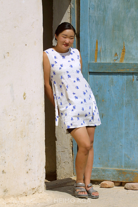 GOBI DESERT, MONGOLIA..08/31/2001.Bayangovi. Young lady owning a textile shop..(Photo by Heimo Aga).